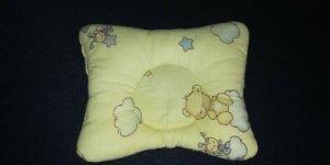 Подушка для новорожденого