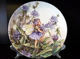 Продам фарфоровые, декоративные, английские тарелки с цветами и феями.